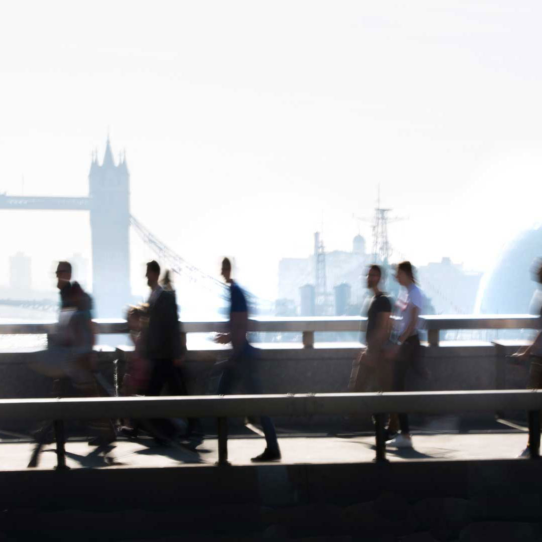 Commuters on their way to work in London over River Thames